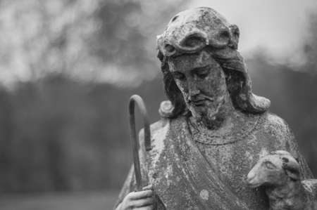 Statue of Christ with a lamb found in a cementery in Hot Springs Virginia Stock Photo