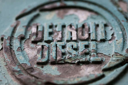 metalschrott: Detail of the engine cover of an abandoned crane stating the place of manufacture Lizenzfreie Bilder