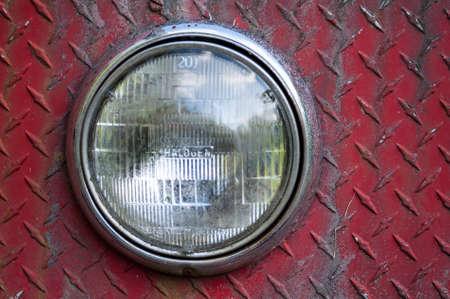 Headlights on rusted and weathered diamond plate sheet metal