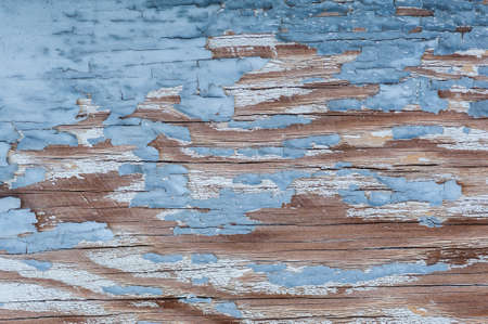 Aged, weathered and peeling paint surface background.