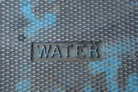 cast iron: Iron sidewalk valve cover Stock Photo