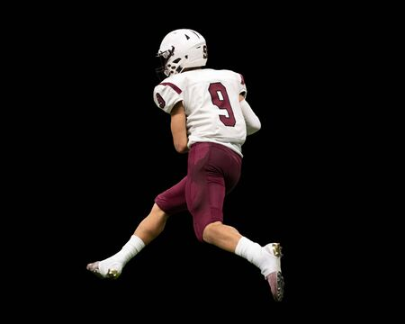 High School Football player in action during a game in South Texas Reklamní fotografie