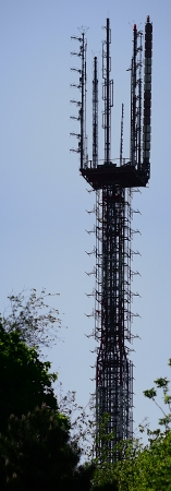 Very high Fermi construction tv tower on blue sky background