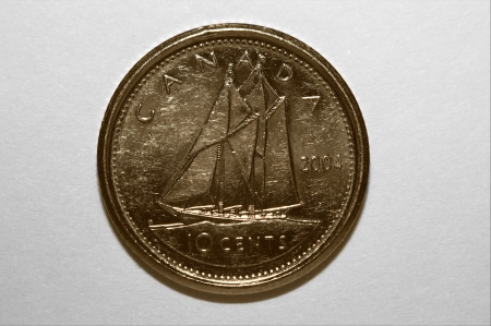 hardly: Canadian ten cents hardly used ship side macro