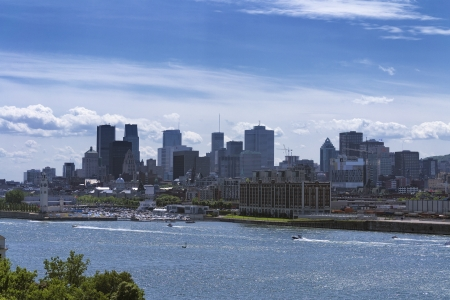 laurence: Montreal downtown scyscrapers and Saint-Laurence river on blue sky Editorial