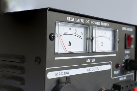 regulated: Black regulated power supply with ampermeter and voltmeter Stock Photo
