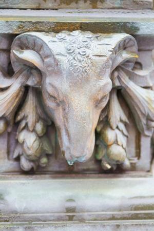 corn flower: Bronze ram head bas-relief