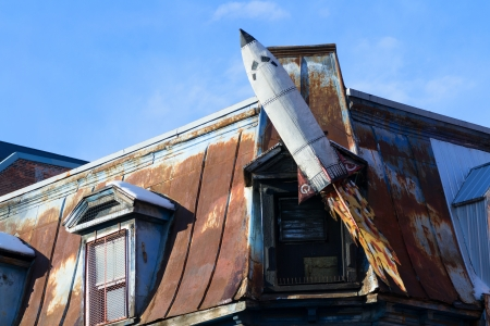 Rusted space shuttle model at the roof