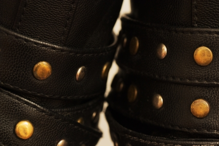 rivets: Black leather ornaments with steel rivets support on shoes Stock Photo