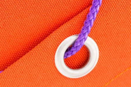 tight focus: Ring and cord on orange fabric macro