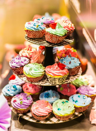 sweet shop: Colored cakes arranged in three levels  on sweet shop