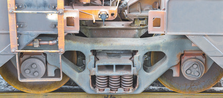goods train: Railway wheels and damper springs close-up Stock Photo