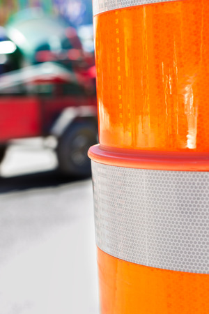 Route warning cone closeup on firetruck background blur photo