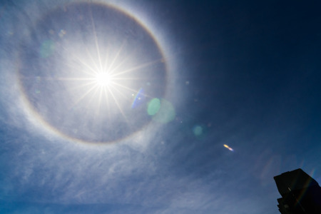 cirrus: MONTREAL CANADA MAY 29 Ring around Sun on may 29 2014 in Montreal, Quebec, Canada  Rare event due to water droplets or ash particles in high athmosphere