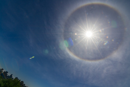 cirrus: Ring around Sun from water or ash particles on blue sky background over Montreal Stock Photo