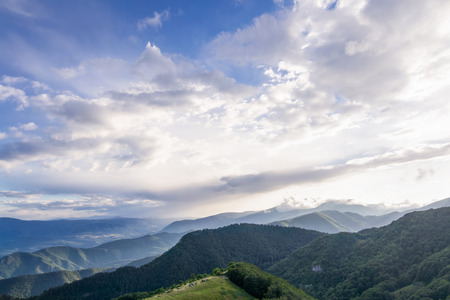 Mountain landscape with sky and clouds wideangle photo