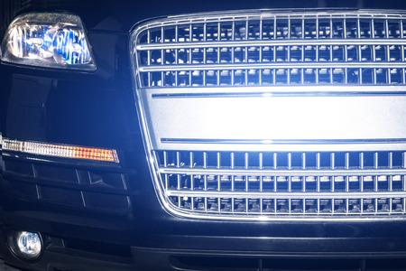 xenon: Car night front reflection from  xenon lights closeup Stock Photo