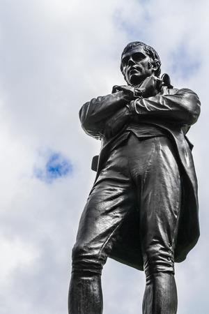 Statue of thinker men on white sky background