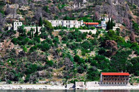 Mediaval ruins and new buildings of New Thebais monastery at Mount Athos Greece Stock Photo