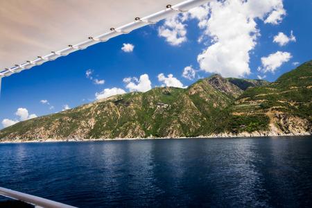 Ship cruise in Mediteranean sea around Agion Oros - Holly Mountain Greece with monastery Simonos Petra at the background Stock Photo