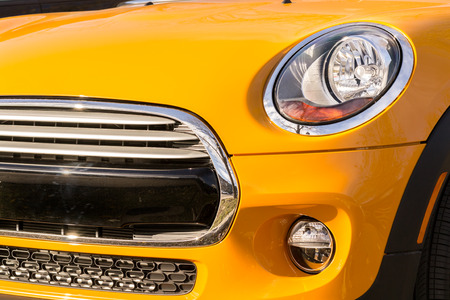 grille: New orange car bumper and grille front view closeup