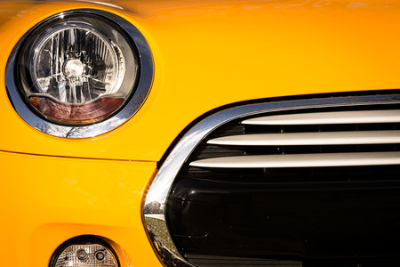 cooper: Front grille and bumper of yellow sport car