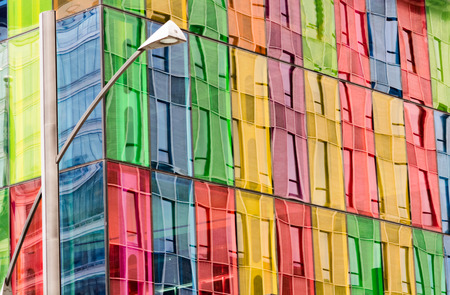 Building facade reflected on colored windows of Montreal Convention center