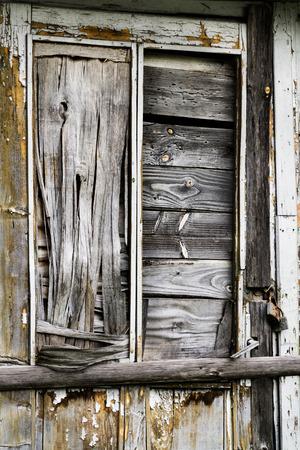 door casing: Old abandonned wooden door closeup Stock Photo