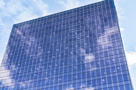 Sky and clouds reflection on building glass facade Stock Photo