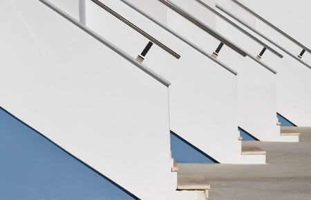 upstairs: White blue repeated pattern upstairs with rails  to modern homes entrances Stock Photo