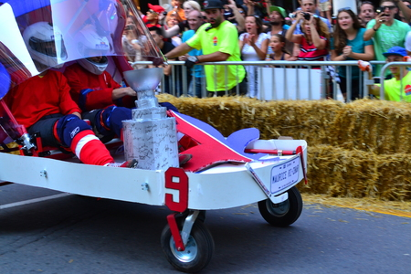 ingenious: Montreal, Canada - September 06, 2015: Montreal Red Bull Soapboax Race in Montreal Downtow.A lot of fun and ingenious ideas.Number 9-Quebec hokey team.