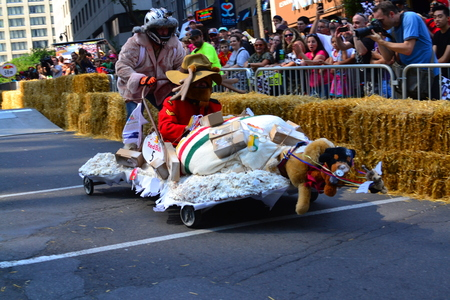 red bull: Montreal, Canada - September 06, 2015: Montreal Red Bull Soapboax Race in Montreal Downtow.A lot of fun and ingenious ideas.Number 5-Canada post team.
