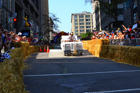 red bull: Montreal, Canada - September 06, 2015: Montreal Red Bull Soapboax Race in Montreal Downtow.A lot of fun and ingenious ideas.Number 11-Chrysler team.