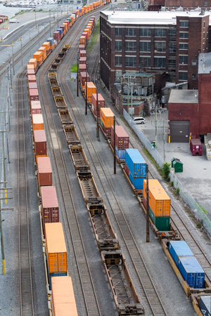 complicated journey: Montreal, Canada - June 07, 2015: Three trains carrying containers waiting on Old Port of Montreal, Canada