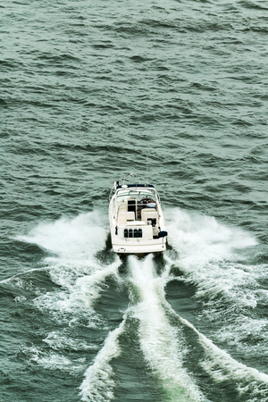 laurent: Small motorboat with two passengers navigate in green waters of Saint Laurent river Stock Photo