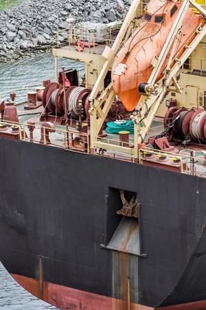 lifesaving: Orange lifesaving boat on tanker back closeup