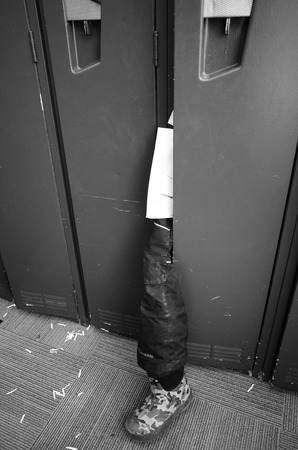 Trouser leg with shoe sorting from the dress locker Stock Photo