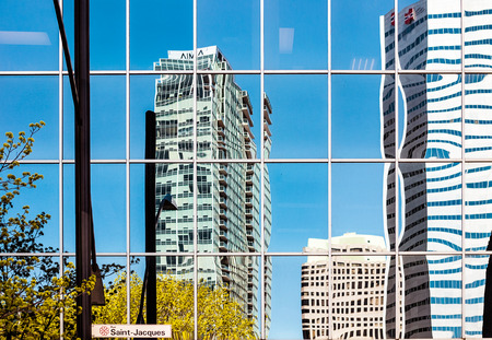 Montreal skyscrapers reflections on Saint-Jacque street in downtown