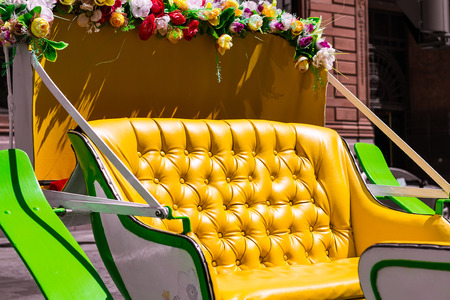 hackney carriage: Yellow horse cab with flowers