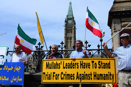 protesting: Ottawa, Canada - May 21, 2016: Iranians protesting on front of Parliament Hill against mullah executions of people in Iran