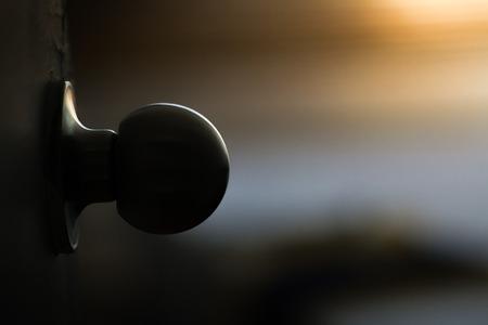 Ball door handle at the dark with light countours around