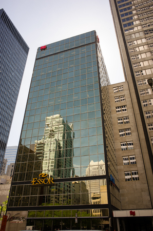 kin: Montreal, Canada - June 04, 2015: Kin EssorNational Bank skyscrapper facade reflections in Montreal downtown Editorial