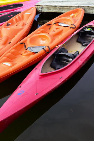 Colored kayaks floating on lake attached to pier in Ottawa,Canada closeup