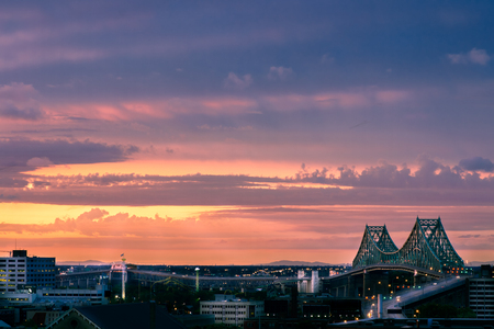 laurence: Montreal Jacque Cartier bridge over Saint laurence river at sunset