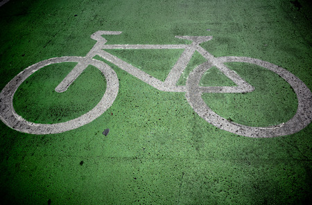 Bicycle paint on green route Stock Photo