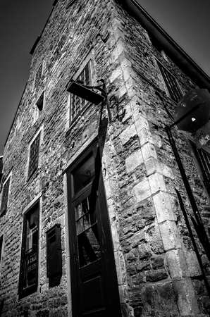 country house style: Old stone house  facade in Old Montreal in black and white Stock Photo