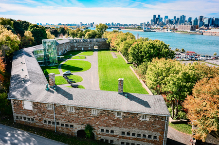 Old Montreal military fort with  St-Laurence river and downtown on background at autumn