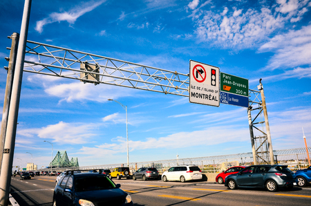 Car and truck traffic on Jacques Cartier bridge in Montreal