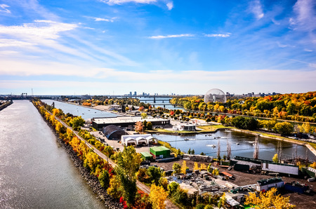 laurence: Montreal Saint Laurence river with St-Helene isle ,Maritime route,cars speed track and downtown in autumn
