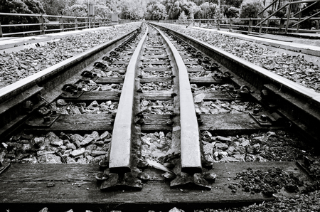 Montreal railway going to forest in black and white Stock Photo